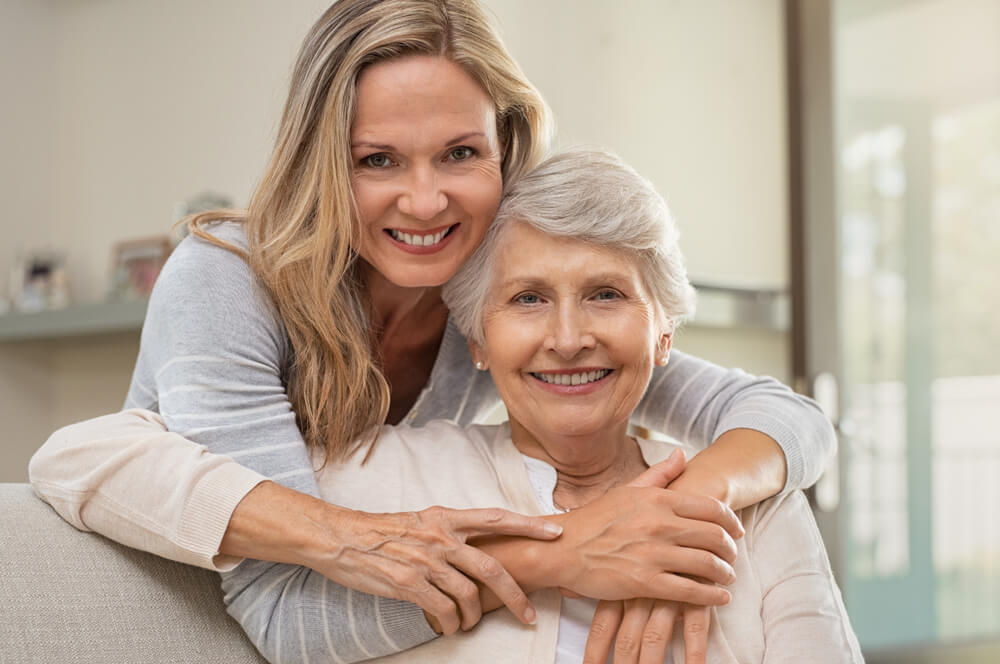 grandmother with her daughter smiling
