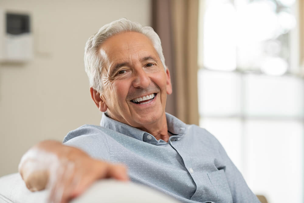 older man smiling, free from gum disease