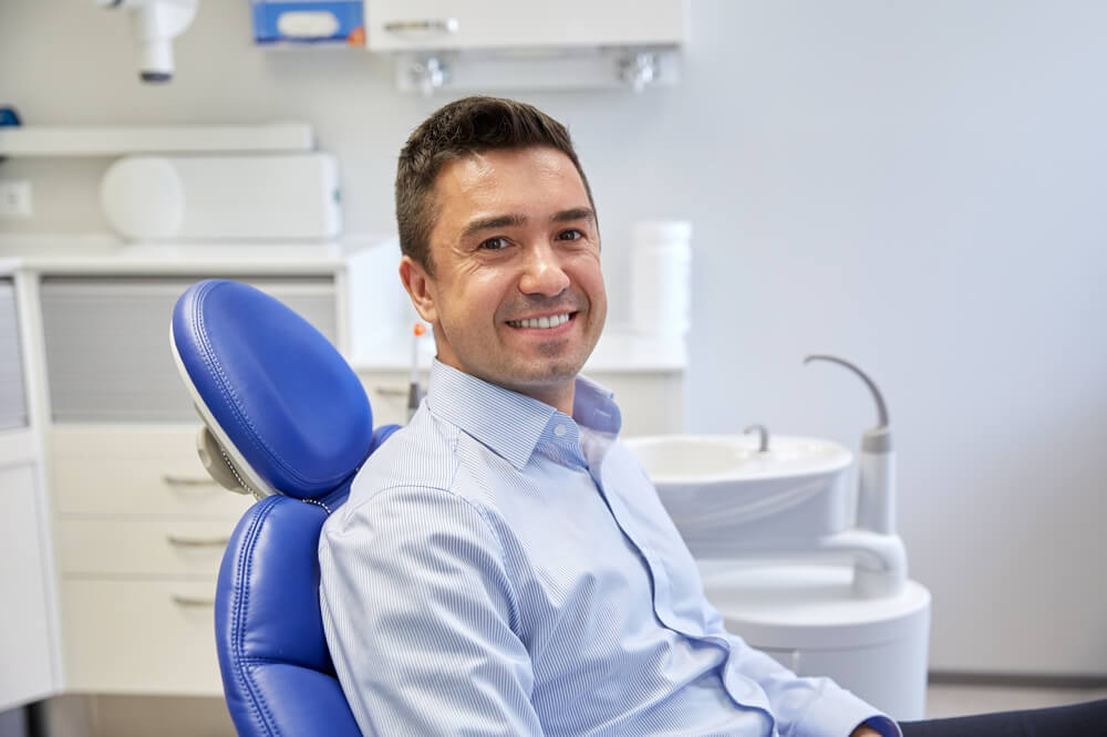 hispanic dental patient waiting in dental chair